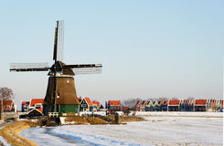 Dutch windmill and winter landscape in Holland Royalty Free Stock Photo