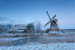 Dutch windmill at winter sunrise Stock Photos