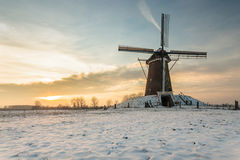 Dutch windmill in wintertime. During sunset Stock Photography