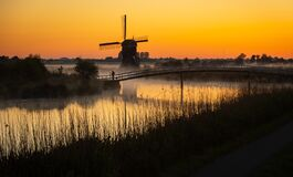 Free Dutch Windmill With Photographer In The Mist Stock Image - 184435971