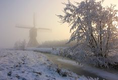 Dutch windmilll in winter Stock Images