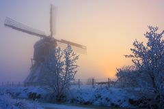 Dutch windmilll in winter Royalty Free Stock Image