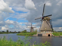 Dutch windmills. Windmills at Kinderdijk in typical dutch weather, Zuid-Holland, Netherlands Royalty Free Stock Photography