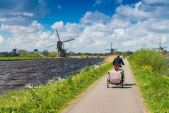 Dutch windmills with canal reflections at Kinderdijk, Netherland Royalty Free Stock Photography