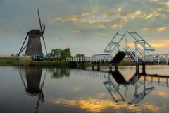 Dutch windmills with canal reflections at Kinderdijk, Netherlands stock image