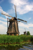 Dutch windmills in countryside Royalty Free Stock Photos