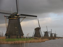 Dutch windmills in Kinderdijk 1. Windmills in a row, Kinderdijk, Holland stock photos