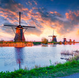 Dutch windmills at Kinderdijk. Colorful spring sunset in Netherlands. Dutch windmills at Kinderdijk, an UNESCO world heritage site Royalty Free Stock Image