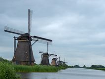 Dutch windmills near small river in Kinderdijk royalty free stock images