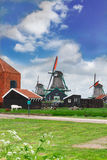 Dutch windmills over  river Royalty Free Stock Image