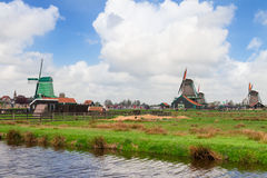 Dutch windmills over  river Royalty Free Stock Images