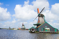 Dutch windmills over  river Stock Images