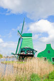 Dutch windmills over  river Stock Image