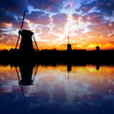 Dutch windmills reflecting on water Royalty Free Stock Photo