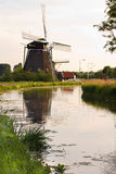 Dutch windmills with reflection Stock Photography