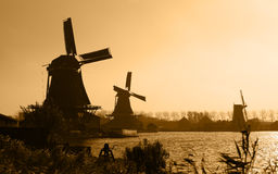 Dutch windmills silhouettes Stock Photo