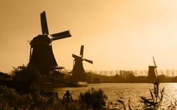 Dutch windmills silhouettes. Silhouettes of traditional Dutch windmills in Zaanse Schans Stock Photo