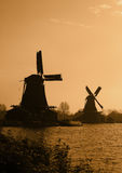 Dutch windmills silhouettes Stock Images