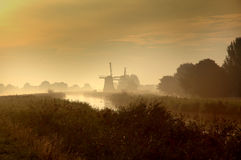 Dutch windmills at sunset Royalty Free Stock Images
