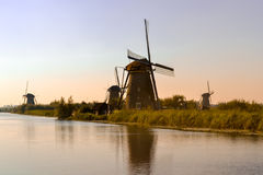 Dutch windmills at sunset Stock Photo