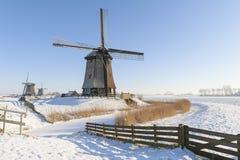 Dutch windmills in winter landscape Royalty Free Stock Photo