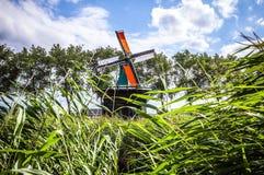 Dutch windmills in Zaandam with dramatic cloudy sky. Royalty Free Stock Photography