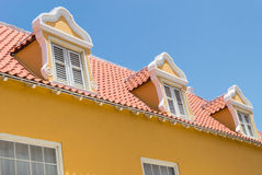 Dutch window and red tiled roof Stock Image