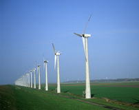 Dutch Windpark. Modern windmills in a line at a windpark in the Netherlands Royalty Free Stock Photography