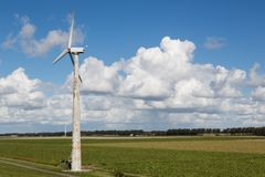 Dutch windturbine in rural landscape of Flevoland Royalty Free Stock Images