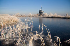 Dutch winter landscape. With windmill Stock Photos