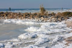 Dutch winter landscape with frozen sea and drifting ice. Near the coast Stock Photography