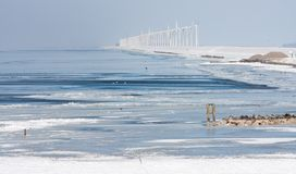 Dutch winter seascape with windturbines Royalty Free Stock Image
