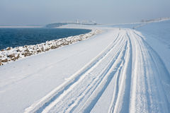 Dutch winter with snowy dike Stock Image