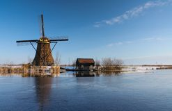 Dutch winterlandscape with windmill Stock Photos