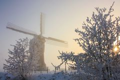 Dutch winterlandscape with windmill Stock Images