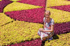 Dutch woman as tourist between colorful plants. Caucasian woman as tourist in botanical garden stock image