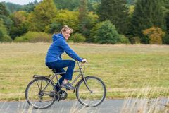 Dutch woman cycling on mountain bike stock image