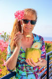 Dutch woman eating melon near pink oleander royalty free stock photo