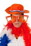 Dutch woman in orange as soccer fan. Dutch woman cross eyed dressed in orange with big sunglasses as a soccer fan Stock Images