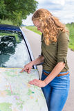 Dutch woman reading road map on car hood Stock Images