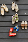 Dutch wooden clogs. Traditional dutch wooden shoes hanging at a wall Stock Photos