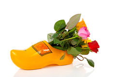 Dutch wooden shoe with colorful roses Royalty Free Stock Photos