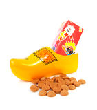 Dutch wooden shoe with presents and pepernoten Stock Photos