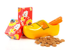 Dutch wooden shoe with presents and pepernoten Royalty Free Stock Images