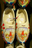 Dutch wooden shoes. Traditional dutch wooden shoes in multiple colors stock image