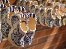 Dutch wooden shoes clogs. Delft blue Dutch wooden shoes in a souvenir shop Stock Photo