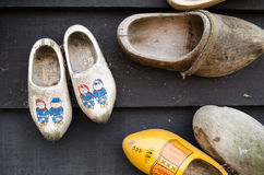 Dutch wooden shoes hanging on a wall as decoration Stock Images