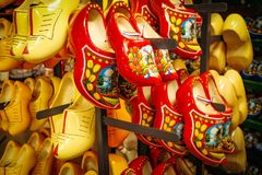 Free Dutch Wooden Shoes In The Souvenir Shop. Red And Yellow Clog And Royalty Free Stock Photos - 106511778
