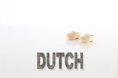 Dutch Words Typography with a Pair of Wooden Shoes Royalty Free Stock Photos