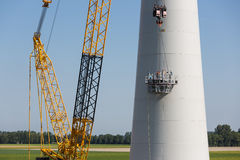 Dutch workers busy with the constuction of a new windturbine Stock Photos